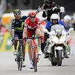 Russian Ilnur Zakarin (C) crosses the finish line ahead of Colombian Nairo Quintana to win the second stage, 171,8km from Moundon to Morgins, during the 70th Tour de Romandie cycling stage on April 28, 2016, in Morgins, western Switzerland. / AFP PHOTO / FABRICE COFFRINI