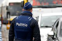 Belgian police officers make checks at the border from France to Belgium in De Panne February 24, 2016, after Belgium set up border checks along its frontier with France to avoid migrants bound for Britain choosing the country as a transit point, as a large camp near the French city of Calais is set to be cleared, Belgium's interior minister said. REUTERS/Francois Lenoir TPX IMAGES OF THE DAY