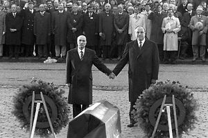 Historical gesture: French president Francois Mitterand (l) and chancellor Helmut Kohl reach out their hands to each other above the graves of Verdun on the 22nd of September in 1984.