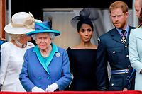 "(FILES) In this file photo taken on July 10, 2018 (L-R) Britain's Camilla, Duchess of Cornwall, Britain's Queen Elizabeth II, Britain's Meghan, Duchess of Sussex, Britain's Prince Harry, Duke of Sussex, AND Britain's Prince William, Duke of Cambridge come onto the balcony of Buckingham Palace to watch a military fly-past to mark the centenary of the Royal Air Force (RAF). - Britain's Prince Harry and his wife Meghan will step back as senior members of the royal family and spend more time in North America, the couple said in a shock announcement on January 8, 2020. The surprise news follows a turbulent year for the monarchy, with signs that the couple have increasingly struggled with the pressures of royal life and family rifts. ""We intend to step back as 'senior' members of the royal family and work to become financially independent, while continuing to fully support Her Majesty The Queen,"" they said in a statement released by Buckingham Palace. (Photo by Tolga AKMEN / AFP)"