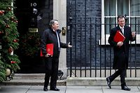 Britain's International Trade Secretary Liam Fox (L) and Britain's Culture Secretary Jeremy Wright leaves from 10 Downing Street in central London on December 18, 2018, after attending the weekly meeting of the Cabinet. - British ministers met on Tuesday to intensify plans for leaving the European Union without a deal -- a prospect that is becoming more likely as Prime Minister Theresa May plays for time with just 101 days to go until Brexit. (Photo by Tolga AKMEN / AFP)