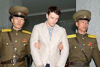 Warmbier unter schwerer Bewachung auf dem Weg zum obersten Gerichtshof Nordkoreas.