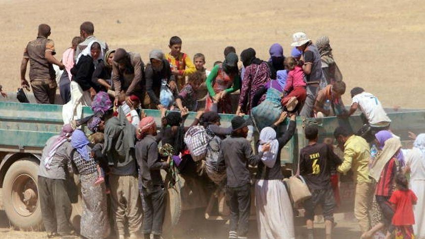 Durant l'été 2014,des déplacés de la communauté yézidie, en fuite devant l'avancée des tueurs de Daech.