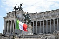 The Italian flag flies at half-mast on the Altare della Patria - Vittorio Emanuele II monument in Rome on March 31, 2020 as flags are being flown at half-mast in cities across Italy to commemorate the victims of the virus, during the country's lockdown aimed at curbing the spread of the COVID-19 infection, caused by the novel coronavirus. (Photo by ANDREAS SOLARO / AFP)
