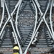 A French state-owned railway company SNCF worker inspects the tracks at a SNCF depot station in Charenton-le-Pont near Paris, France, May 31, 2016 as railway workers will start a national railway strike on Tuesday evening.  REUTERS/Charles Platiau