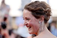 """Luxembourg actress Vicky Krieps arrives for the screening of the film """"Serre-moi Fort"""" (Hold Me Tight) at the 74th edition of the Cannes Film Festival in Cannes, southern France, on July 14, 2021. (Photo by Valery HACHE / AFP)"""