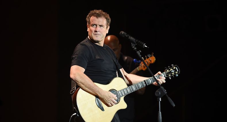 (FILES) In this file photo taken on June 16, 2014, South African singer Johnny Clegg performs during the 20th edition of the World Sacred Music Festival in Fez, Morocco. - South African singer Johhny Clegg has died at the age of 66, his manager said, on July 16, 2019. (Photo by Fadel SENNA / AFP)