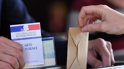A person casts his ballot at a polling station in Strasbourg