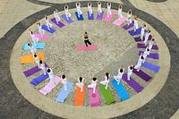TOPSHOT - This aerial photo shows yoga enthusiasts practising yoga at a park in Handan in China's northern Hebei province on June 19, 2020, ahead of International Yoga Day celebrated annually on June 21. (Photo by STR / AFP) / China OUT