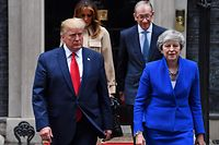 Britain's Prime Minister Theresa May (R) and US President Donald Trump (L), are followed by her husband Philip May (2R) and US First Lady Melania Trump as they leave 10 Downing Street to make their way to the Foreign and Commonwealth office for a press conference in London on June 4, 2019, on the second day of the US President's three-day State Visit to the UK. - US President Donald Trump turns from pomp and ceremony to politics and business on Tuesday as he meets Prime Minister Theresa May on the second day of a state visit expected to be accompanied by mass protests. (Photo by Ben STANSALL / AFP)