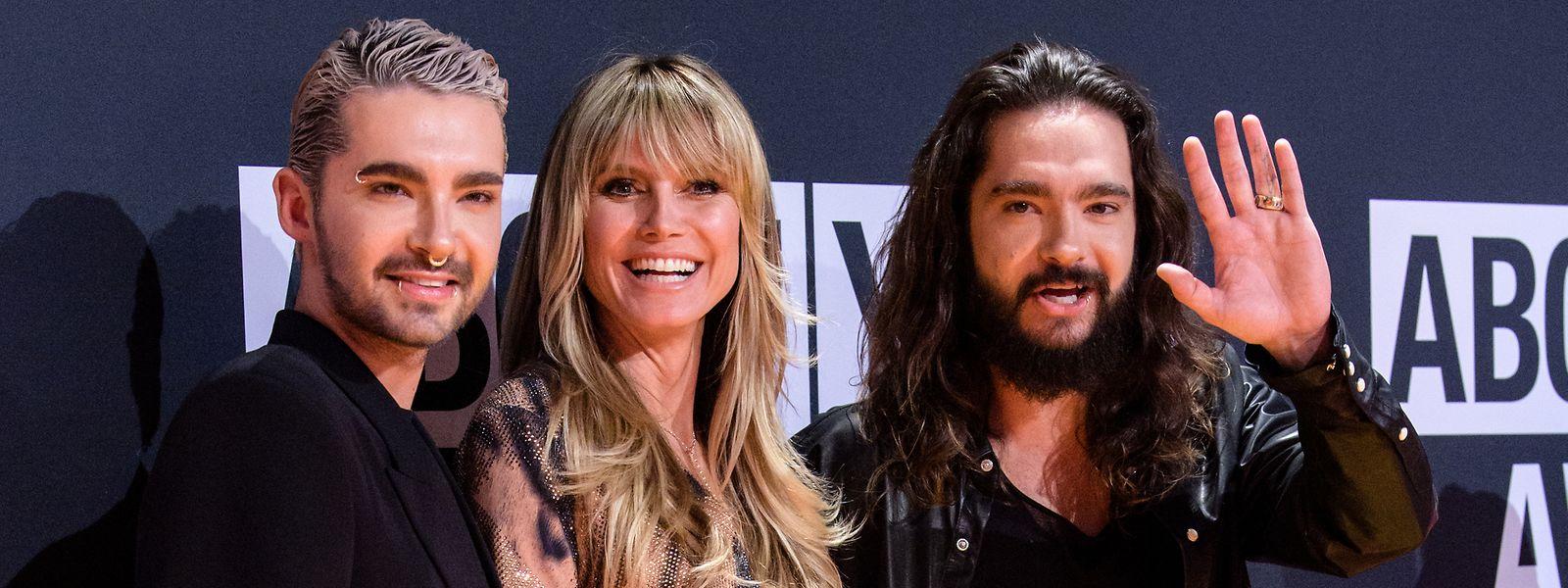 Nein, es ist nicht ihre Mutter: Bill (l.) und Tom Kaulitz mit Heidi Klum.