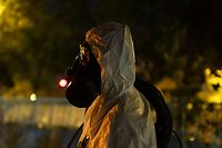 A member of the Spanish Military Emergencies Unit (UME) wearing protective gear prepares to disinfect the Lope de Vega Cultural Center in the Vallecas neighbourhood where rapid antigen test for COVID-19 were conducted to residents of the area, on September 30, 2020 in Madrid. - The Spanish government said it had reached an agreement to impose a partial lockdown on the entire city of Madrid where coronavirus cases are spreading like wildfire. (Photo by OSCAR DEL POZO / AFP)