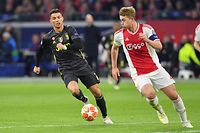 (FILES) In this file photo taken on April 10, 2019 Juventus' Portuguese forward Cristiano Ronaldo (L) and Ajax's Dutch defender Matthijs de Ligt run with the ball during the UEFA Champions League first leg quarter-final football match between Ajax Amsterdam and Juventus FC at the Johan Cruijff Arena in Amsterdam. - Matthijs de Ligt is closing in on a move to Juventus after Ajax announced on July 13, 2019 that the rising star will skip the Dutch champions pre-season training camp due to his expected departure. (Photo by EMMANUEL DUNAND / AFP)