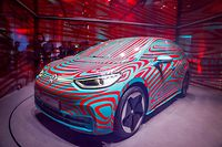 (FILES) In this file photo taken on May 08, 2019 A Volkswagen ID 3 electric car is seen in a glass cage during a press conference in Berlin - Volkswagen will present its first version of their brand's first ID. model on late September 9, 2019 at Frankfurt's biennial International Auto Show (IAA). (Photo by Odd ANDERSEN / AFP)