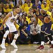 OAKLAND, CA - JUNE 01: Kyrie Irving #2 of the Cleveland Cavaliers is defended by Stephen Curry #30 of the Golden State Warriors in Game 1 of the 2017 NBA Finals at ORACLE Arena on June 1, 2017 in Oakland, California. NOTE TO USER: User expressly acknowledges and agrees that, by downloading and or using this photograph, User is consenting to the terms and conditions of the Getty Images License Agreement.   Ezra Shaw/Getty Images/AFP