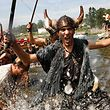 People of Catoira village, in Galicia, northwestern Spain 05 August 2007 simulate the assault of Scandinavian warriors, in viking garb with a replica viking ship on the coast of Galicia 1000 years ago. AFP PHOTO/MIGUEL RIOPA (Photo by MIGUEL RIOPA / AFP)