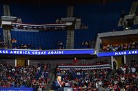 The upper section of the arena is seen partially empty as US President Donald Trump speaks during a campaign rally at the BOK Center on June 20, 2020 in Tulsa, Oklahoma. - Hundreds of supporters lined up early for Donald Trump's first political rally in months, saying the risk of contracting COVID-19 in a big, packed arena would not keep them from hearing the president's campaign message. (Photo by Nicholas Kamm / AFP)