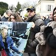 A woman cries as she stands with others fans near the house of late French singer and actor Johnny Hallyday, on December 6, 2017, in Marnes-la-Coquette. France's best-known rock star Johnny Hallyday has died aged 74 after a battle with lung cancer, his wife Laeticia told AFP on December 6, 2017. / AFP PHOTO / Eric FEFERBERG