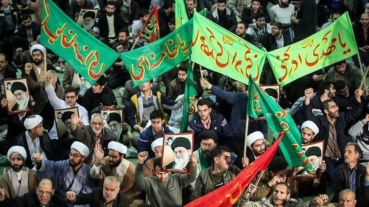 Iranians chant slogans as they march in support of the government near the Imam Khomeini grand mosque in the capital Tehran (AFP)