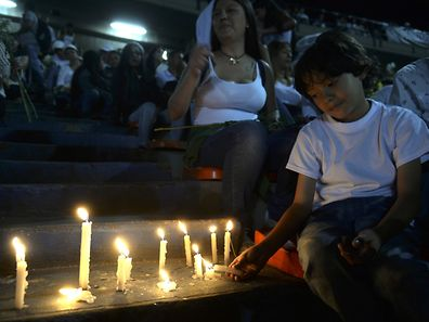 People take part in a tribute to the victims of a plane crash in the Colombian mountains that killed 71 and virtually wiped out the Brazilian football team Chapecoense Real, at the Atanasio Girardot Stadium in Medellin, Colombia, on November 30, 2016.