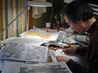 (FILES) This file picture taken on March 5, 2012 shows Japanese comic artist Jiro Taniguchi drawing in his studio in Tokyo.  Jiro Taniguchi, a legend in Japan's comic art of manga, died in Tokyo on February 11, 2017 at the age of 69, leaving behind an international following for his exquisite line drawing of scenes from everyday life. / AFP PHOTO / Karyn NISHIMURA-POUPEE
