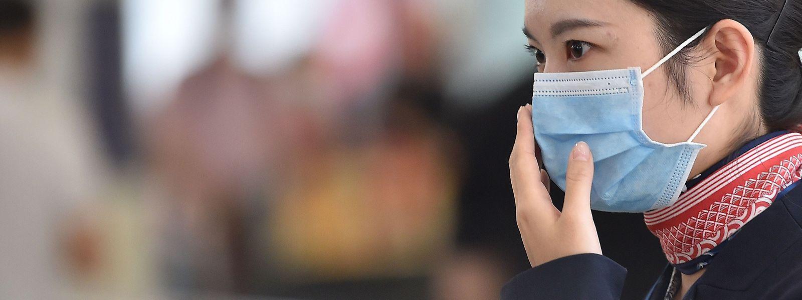 In Wuhan ist das Tragen von Masken an vielen Orten vorgeschrieben.