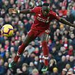 Liverpool's Senegalese striker Sadio Mane jumps to win a header during the English Premier League football match between Liverpool and Bournemouth at Anfield in Liverpool, north west England on February 9, 2019. (Photo by Paul ELLIS / AFP) / RESTRICTED TO EDITORIAL USE. No use with unauthorized audio, video, data, fixture lists, club/league logos or 'live' services. Online in-match use limited to 120 images. An additional 40 images may be used in extra time. No video emulation. Social media in-match use limited to 120 images. An additional 40 images may be used in extra time. No use in betting publications, games or single club/league/player publications. /
