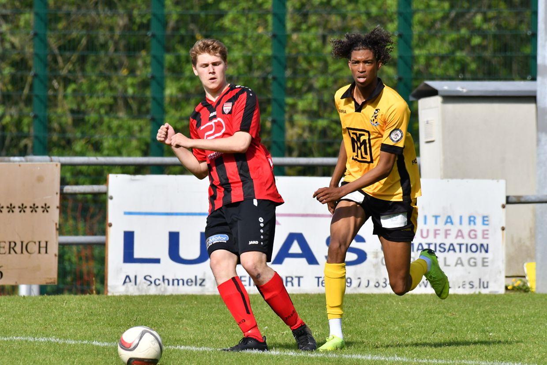 Koerich - Beggen 1-2. - Bob Scheidel (en rouge, FC Koerich) et Edgar Neves (Avenir Beggen).
