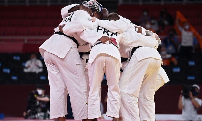 Team France celebrates winning their judo mixed team's semifinal B bout against Netherlands during the Tokyo 2020 Olympic Games at the Nippon Budokan in Tokyo on July 31 2021.