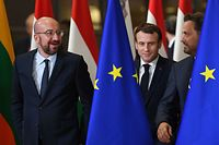 (FRom L) President of the European Council Charles Michel, France's President Emmanuel Macron and Luxembourg's Prime Minister Xavier Bettel prepare for a family picture during the European Union Summit at the Europa building in Brussels on December 12, 2019. - European Union leaders meet without Britain on December 12, but their departing neighbour's absence will not make agreeing a budget any easier. Inside the chamber, the clash over climate take Brexit's place as the dominant theme of the summit, the first to be chaired by incoming EU Council president Charles Michel. (Photo by Alain JOCARD / AFP)
