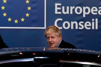 British Prime Minister Boris Johnson leaves an European Union Summit at European Union Headquarters in Brussels on October 18, 2019. (Photo by Kenzo TRIBOUILLARD / AFP)