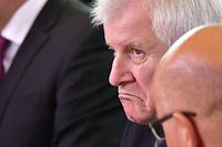German Interior Minister Horst Seehofer awaits the start of the weekly cabinet meeting in Berlin on June 20, 2018. / AFP PHOTO / Tobias SCHWARZ