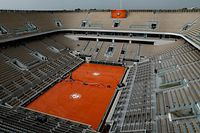 (FILES) This file photo taken on June 4, 2019,  shows a general  view of the empty Philippe Chatrier court during rain, during the men's singles quarter-final match between Spain's Rafael Nadal and Japan's Kei Nishikori, on day ten of The Roland Garros 2019 French Open tennis tournament in Paris. - The Roland Garros French Open tennis tournament, originally scheduled for May 24 to June 7, 2020, has been postponed to run from September 20 to October 4, 2020, due to the outbreak of COVID-19, caused by the novel coronavirus, the French Tennis Federation (FFT) announced on March 17, 2020. (Photo by Thomas SAMSON / AFP)