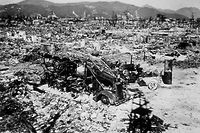 1945:  Atomic bomb damage at Hiroshima with a burnt out fire engine amidst the rubble.  (Photo by Keystone/Getty Images)