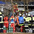 Firefighters and emergency doctors work at the site of a train accident near Bad Aibling, southern Germany, on Tuesday