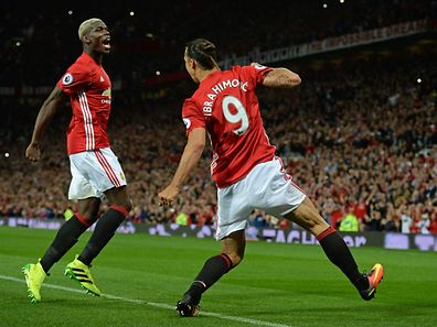 Manchester United's Swedish striker Zlatan Ibrahimovic (R) celebrates with Manchester United's French midfielder Paul Pogba after scoring their second goal from the penalty spot during the English Premier League football match between Manchester United and Southampton at Old Trafford in Manchester, north west England, on August 19, 2016. / AFP PHOTO / Oli SCARFF / RESTRICTED TO EDITORIAL USE. No use with unauthorized audio, video, data, fixture lists, club/league logos or 'live' services. Online in-match use limited to 75 images, no video emulation. No use in betting, games or single club/league/player publications.  /