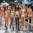 (FromL) Models Nadine Leopold, Shanina Shaik, Herieth Paul, Barbara Fialho, Toni Garrn, and Aiden Curtiss walk the runway at the 2018 Victoria's Secret Fashion Show on November 8, 2018 at Pier 94 in New York City. - Every year, the Victoria's Secret show brings its famous models together for what is consistently a glittery catwalk extravaganza. It's the most-watched fashion event of the year (800 million tune in annually) with around 12 million USD spent on putting the spectacle together according to Harper's Bazaar. (Photo by TIMOTHY A. CLARY / AFP)