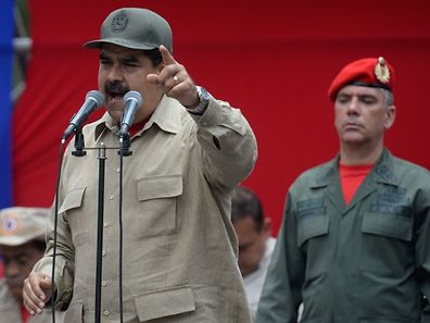 "Venezuelan President Nicolas Maduro delivers a speech during the seventh anniversary of the Bolivarian Militia in Caracas on April 17, 2017. Venezuela's defence minister on Monday declared the army's loyalty to Maduro, who ordered troops into the streets ahead of a major protest by opponents trying to oust him. Venezuela is bracing for what Maduro's opponents vow will be the ""mother of all protests"" Wednesday, after two weeks of violent demos against moves by the leftist leader and his allies to tighten their grip on power.  / AFP PHOTO / Federico PARRA"