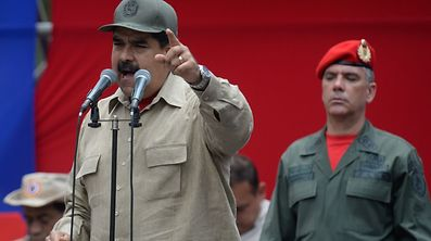 """Venezuelan President Nicolas Maduro delivers a speech during the seventh anniversary of the Bolivarian Militia in Caracas on April 17, 2017. Venezuela's defence minister on Monday declared the army's loyalty to Maduro, who ordered troops into the streets ahead of a major protest by opponents trying to oust him. Venezuela is bracing for what Maduro's opponents vow will be the """"mother of all protests"""" Wednesday, after two weeks of violent demos against moves by the leftist leader and his allies to tighten their grip on power.  / AFP PHOTO / Federico PARRA"""