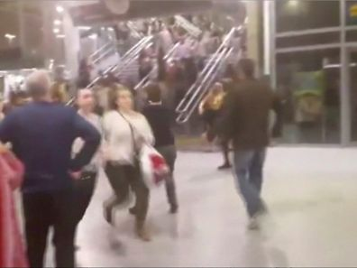 People running down stairs as they attempt to exit the Manchester Arena after a blast, where U.S. singer Ariana Grande had been performing, in Manchester, Britain in this still image taken from video May 22, 2017. @ZACH_BRUCE/ via REUTERS TV ATTENTION EDITORS - BROADCASTERS: MUST COURTESY @ZACH_BRUCE WITH NO ARCHIVAL USE AND NO RESALE. DIGITAL: MUST COURTESY @ZACH_BRUCE WITH NO ARCHIVAL USE AND NO RESALE. FOR REUTERS CUSTOMERS ONLY. FOR EDITORIAL USE ONLY. NO RESALES. NO ARCHIVES. THIS IMAGE HAS BEEN SUPPLIED BY A THIRD PARTY. MANDATORY CREDIT. NO THIRD PARTY SALES. NOT FOR USE BY REUTERS THIRD PARTY DISTRIBUTORS.      TPX IMAGES OF THE DAY