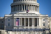 WASHINGTON, DC - JANUARY 09: The American flag flies at half-staff as inauguration construction continues on the West Front of the U.S. Capitol on January 9, 2021 in Washington, DC. A pro-Trump mob stormed and desecrated the U.S. Capitol on January 6 as Congress held a joint session to ratify President-elect Joe Biden's 306-232 Electoral College win over President Donald Trump.   Al Drago/Getty Images/AFP == FOR NEWSPAPERS, INTERNET, TELCOS & TELEVISION USE ONLY ==