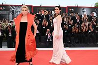 """French actress Catherine Deneuve (L) and French actress Juliette Binoche arrive for the opening ceremony and the screening of the film """"La Verite"""" (The Truth) presented in competition on August 28, 2019 during the 76th Venice Film Festival at Venice Lido. (Photo by Alberto PIZZOLI / AFP)"""