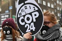Protesters are pictured prior to a march for the climate on sidelines of the 24th Conference of the Parties to the United Nations Framework Convention on Climate Change (COP24) summit on December 8, 2018 in Katowice, Poland. (Photo by Janek SKARZYNSKI / AFP)