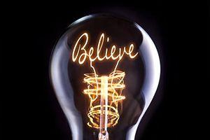 Religion, Faith concept in a filament lightbulb.