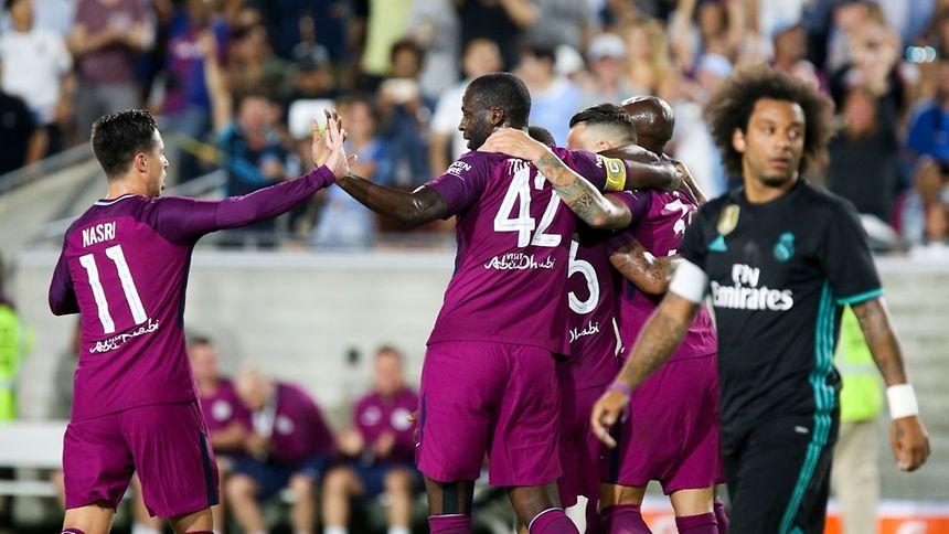 O jogadores do Manchester City celebram um dos golos frente ao Real Madrid