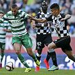 Sporting�s player Slimani (L) in action against Boavista's player Philipe Sampaio (R) during their Portuguese First League soccer match held at Alvalade stadium in Lisbon, Portugal, 19 April 2015. MIGUEL A. LOPES/LUSA