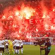 Legia Warsaw's fans burn flares as they celebrate during the second leg of a Champions League playoffs soccer match between Legia Warsaw and Steaua Bucharest in Warsaw, Poland, Tuesday, Aug. 27, 2013. (AP Photo/Czarek Sokolowski)