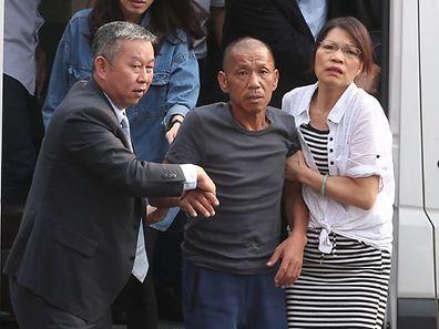 M. Shen, machiniste sur le bateau de pêche capturé, est arrivé mercredi à l'aéroport de Taipei. Il avait retrouvé sa femme et sa fille mardi à Canton.