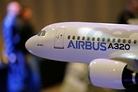 A scale model of an A320 Airbus is displayed during the Airbus annual press conference in Colomiers, near Toulouse, January 13, 2014. Airbus posted an industry record of 1,619 new airplane orders in 2013, pushing its backlog to almost nine years of production, and said it was examining the potential for a two-stage increase in production of its most popular jets.   REUTERS/Regis Duvignau (FRANCE - Tags: TRANSPORT BUSINESS)