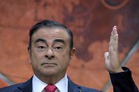 (FILES) In this file photo taken on September 15, 2017 then Renault-Nissan Chairman and CEO Carlos Ghosn gestures as he addresses a press conference in Paris to present the Renault Nissan group strategy. - Former Nissan chief Carlos Ghosn, who was on bail in Tokyo awaiting trial on financial misconduct charges, has arrived in Beirut, Lebanese official and security sources said on December 30, 2019. (Photo by ERIC PIERMONT / AFP)